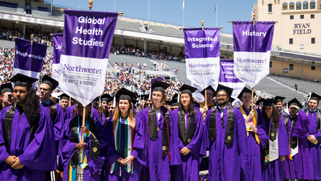The first graduates of the Global Health Studies major in their graduation regalia